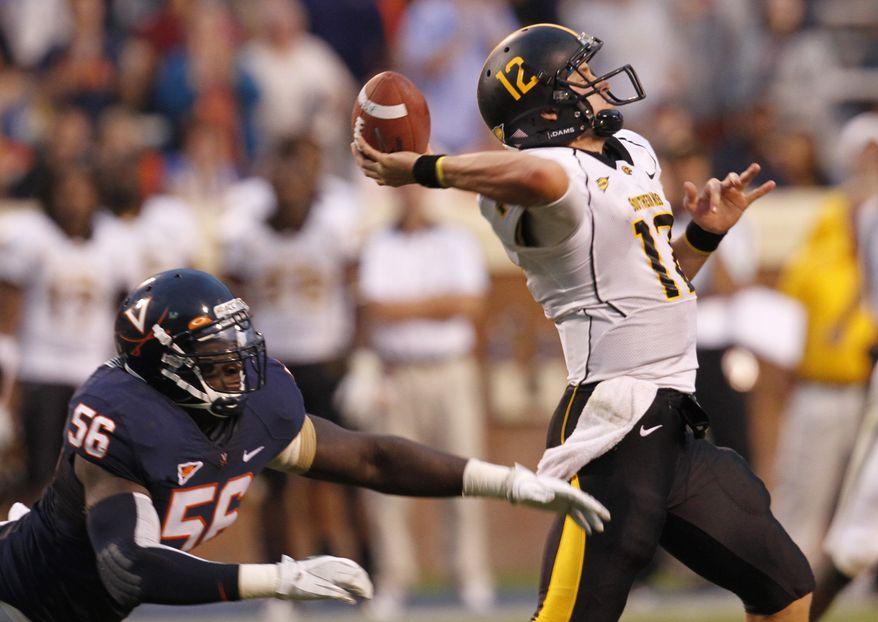 Southern Mississippi quarterback Austin Davis throws a pass as Virginia defensive end Cam Johnson closes in. Davis threw for 186 yards and three touchdowns in Southern Miss' 30-24 win. (AP Photo/Steve Helber)