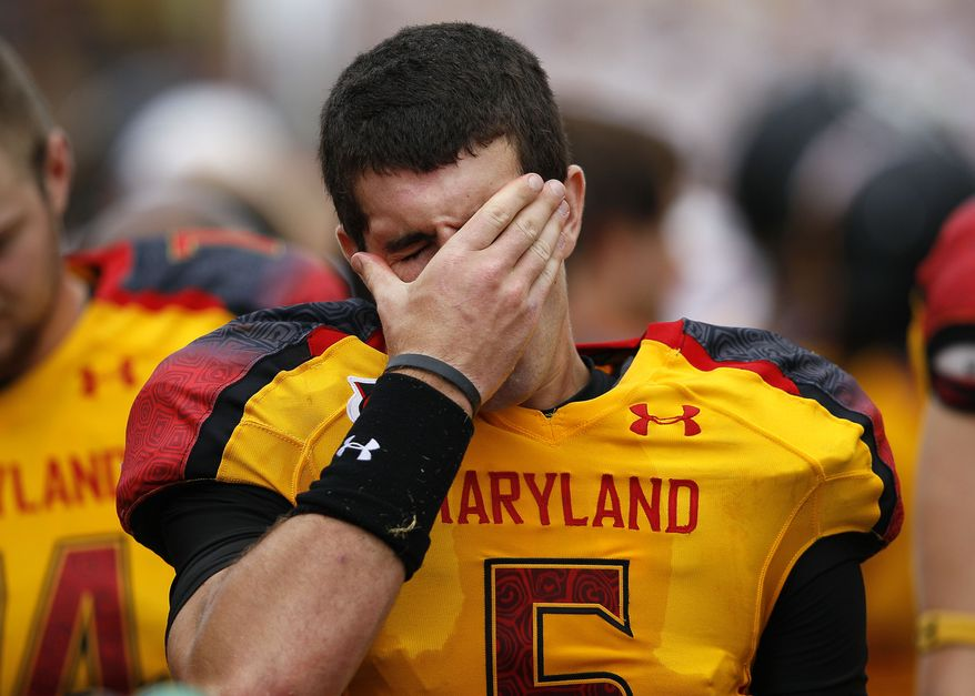 Maryland quarterback Danny O'Brien wipes his face while standing on the sideline in the second half  against Temple. Temple won 38-7, as Maryland barely avoided its first home shutout since 1997. (AP Photo/Patrick Semansky)
