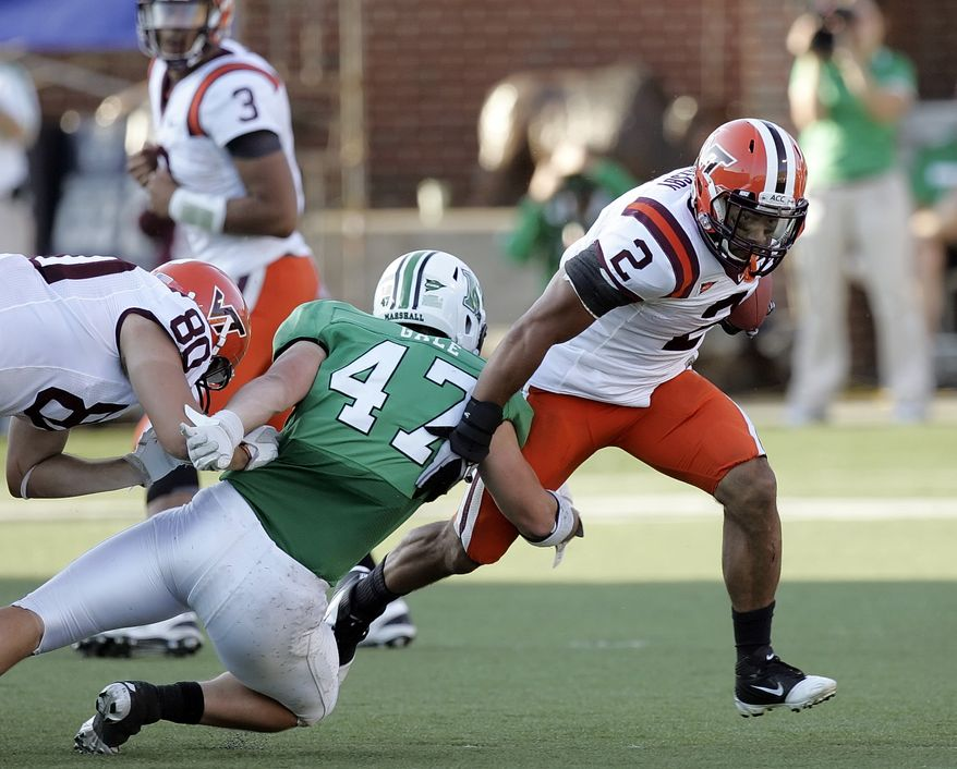 Virginia Tech's Josh Oglesby evades a tackle by Marshall's Tyson Gale on Saturday, Sept. 24, 2011, in Huntington, W.Va. Virginia Tech won 30-10 and Oglesby rushed for 75 yards and two touchdowns. (AP Photo/Randy Snyder)