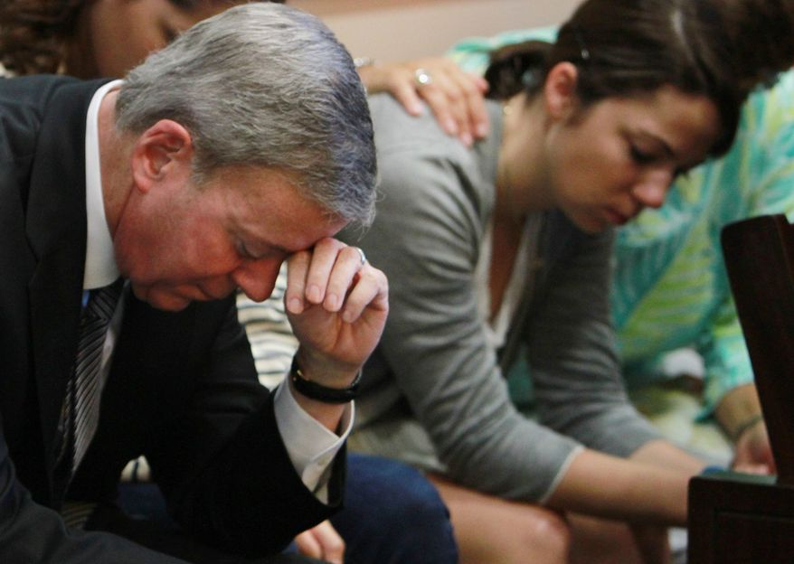 Robert Ward, left, and his daughter Mallory, wait as the jury in the Wards' murder trial returns to court for a second day of deliberations Saturday, Sept. 24, 2011. Ward, a millionaire developer, is charged with second-degree murder in the death of his wife Diane, who was shot in the bedroom of their Isleworth mansion in 2009. (AP Photo/Pool, Red Huber)