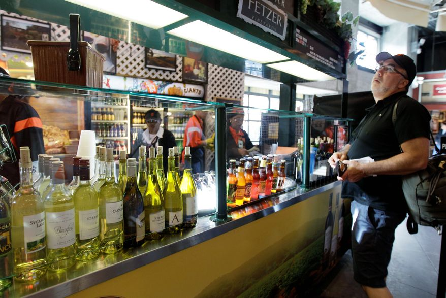 A fan looks over the selections at a wine bar at AT&T Park, home of baseball's San Francisco Giants. Wine is an option at many of the nation's ballparks. (Associated Press)
