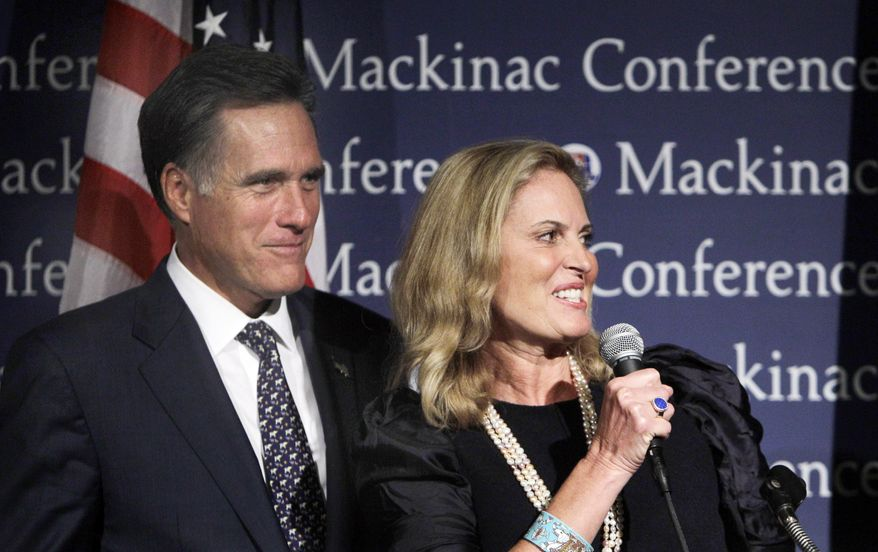 Former Massachusetts Gov. Mitt Romney, a contender for the Republican presidential nomination, and his wife, Ann, share the stage before his address to the Mackinac Republican Leadership Conference on Mackinac Island, Mich., on Saturday, Sept. 24, 2011. (AP Photo/Carlos Osorio)