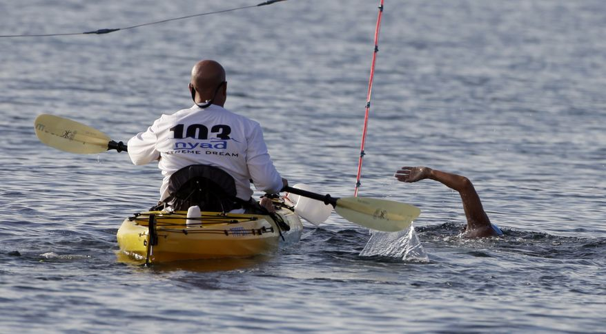 U.S. swimmer Diana Nyad begins her swim from Cuba to Florida at the Hemingway Marina in Havana on Friday, Sept. 23, 2011. (AP Photo/Javier Galeano)