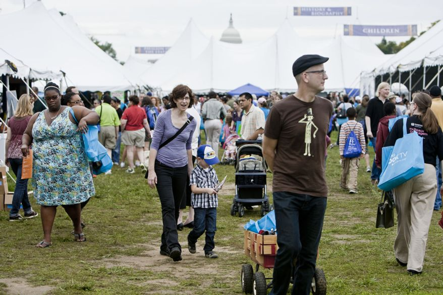 Kelly Caldwell, center, of Washington, D.C., walks with her son Fionn, 4, behind her husband Chris through the National Book Festival on the National Mall in Washington, D.C. on Sept. 25, 2011.(T.J. Kirkpatrick/ The Washington Times)