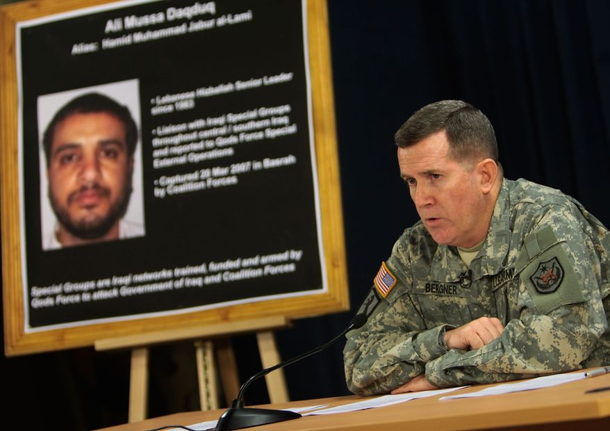 ** FILE ** Brig. Gen. Kevin J. Bergner, a U.S. military spokesman, speaks near a poster of senior Lebanese Hezbollah operative Ali Mussa Daqduq during a press conference in July 2007 in Baghdad. (AP Photo/Wathiq Khuzaie, Pool, File)