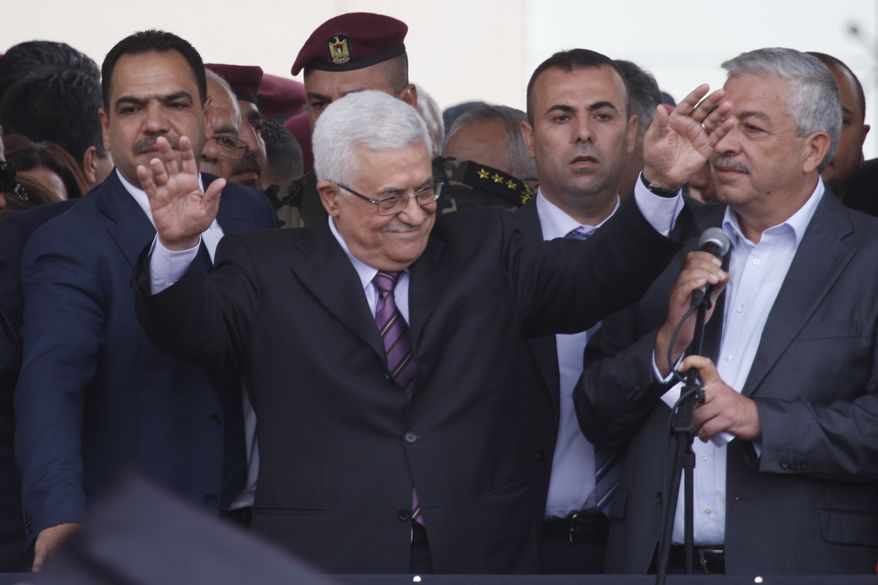 "Palestinian President Mahmoud Abbas waves to supporters upon his arrival at the government compound in the West Bank city of Ramallah on Sunday, Sept. 25, 2011. Mr. Abbas received a hero's welcome, triumphantly telling his people the ""Palestinian Spring"" has begun following his historic speech to the United Nations on Friday. (AP Photo/Majdi Mohammed)"