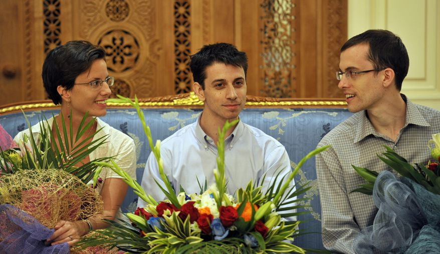 """Sarah Shourd (left), Josh Fattal (center) and Shane Bauer are pictured at the airport in Muscat, Oman, on Saturday, Sept. 24, 2011, before leaving for the United States. The two men, who were freed from an Iranian prison Wednesday, told reporters they were """"eager to go home."""" (AP Photo/Sultan al-Hasani)"""