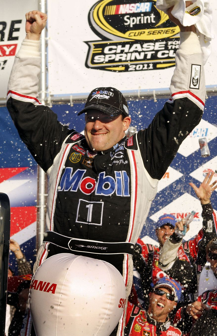 Tony Stewart celebrates with his crew in Victory Lane after winning the NASCAR Sprint Cup Series auto race at New Hampshire Motor Speedway, Sunday, Sept. 25, 2011, in Loudon, N.H. (AP Photo/Jim Cole)