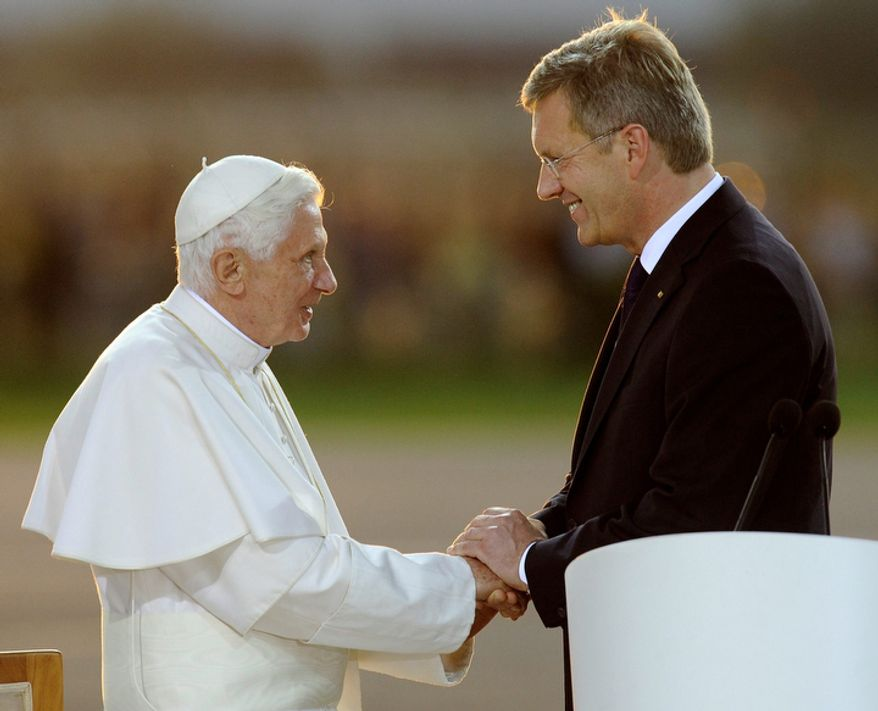 Pope Benedict XVI holds the hand of German president Christian Wulff before departing from the airport in Lahr, north of Freiburg, Germany,  Sunday, Sept. 25, 2011. Pope Benedict XVI was on a four-day official visit to his homeland Germany.  (AP Photo/Martin Meissner)