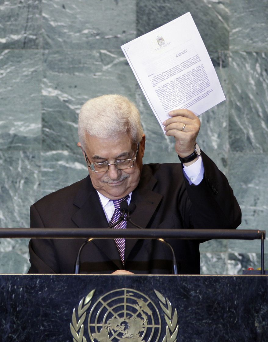 Palestinian President Mahmoud Abbas addresses the 66th session of the U.N. General Assembly in New York on Friday, Sept. 23, 2011. (AP Photo/Richard Drew)