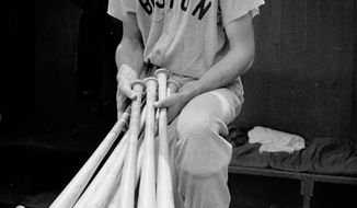 Boston Red Sox outfielder Ted Williams stands July 1, 1941, on the steps of the dugout at Yankee Stadium before the game. (Associated Press)