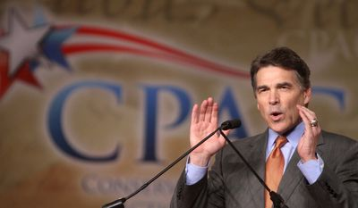 Texas Gov. Rick Perry addresses the Conservative Political Action Conference at the Orange County Convention Center in Orlando, Fla., on Friday. (Associated Press)