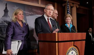 Senate Majority Leader Harry Reid, Nevada Democrat, is joined by fellow Democrats (from left) Sens. Mary L. Landrieu of Louisiana, Chuck Schumer of New York and Debbie Stabenow of Michigan after Monday's vote on a short-term funding bill. (Associated Press)