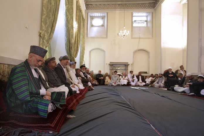 Afghan President Hamid Karzai (left) prays during a memorial service for former Afghan President Burhanuddin Rabbani at the mosque of the Presidential Palace in Kabul, Afghanistan, on Saturday, Sept. 24, 2011. (AP Photo/Kamran Jebreili)