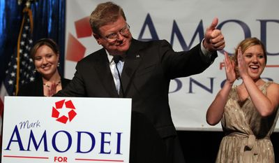 Mark Amodei speaks at a victory party in Reno, Nev., on Sept. 13, 2011, after defeating Democrat Kate Marshall in a special election for Nevada's 2nd Congressional District. Amodei's daughters Erin (left) and Ryanne were among the supporters on hand. (Associated Press)