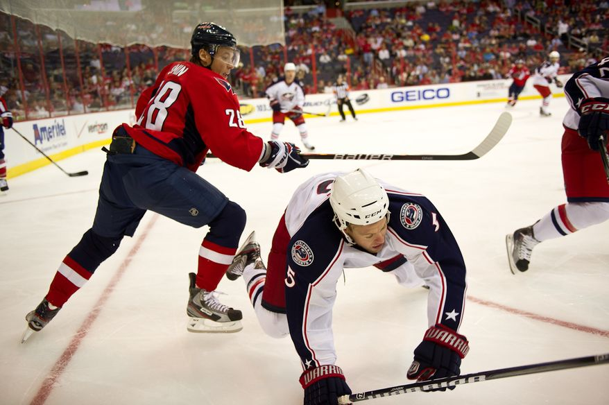 Alexander Semin (28) of the Washington Capitals gets a penalty for tripping Aaron Johnson (5) of the Columbus Blue Jackets in preseason hockey in the second period at the Verizon Center in Washington, DC, Monday, September 26, 2011. (Andrew Harnik / The Washington Times)