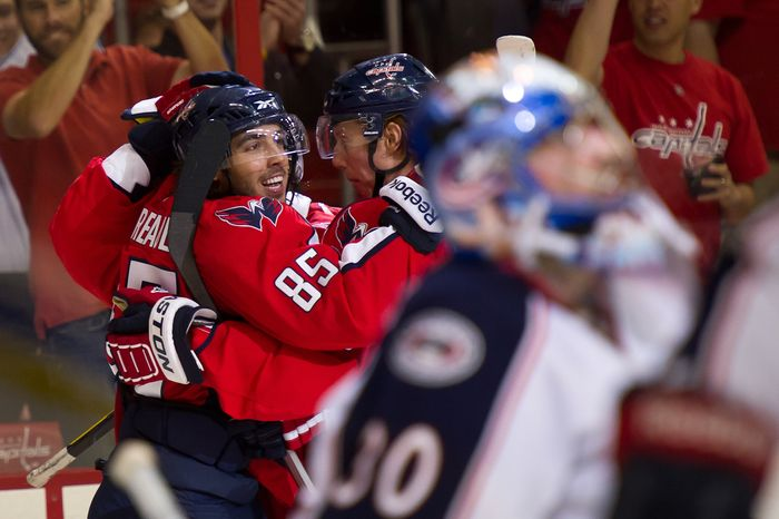 Mathieu Perreault (85) the Washington Capitals celebrates with his team after scoring in the second period against the Columbus Blue Jackets to make the score 3-0 in the second period in preseason hockey at the Verizon Center in Washington, DC, Monday, September 26, 2011. (Andrew Harnik / The Washington Times)