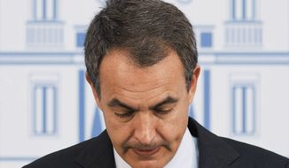 Spanish Prime Minister Jose Luis Rodriguez Zapatero speaks during a press conference after a ministers meeting at the Moncloa Palace in Madrid on Monday, Sept. 26, 2011. (AP Photo/Daniel Ochoa de Olza)