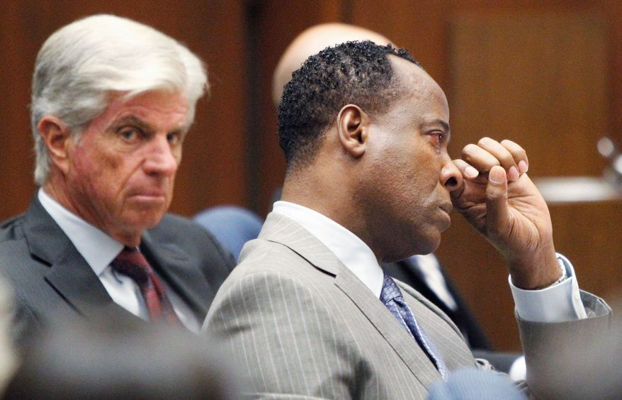Conrad Murray wipes away a tear during the defense's opening arguments in his trial at Superior Court in Los Angeles on Tuesday. Dr. Murray has pleaded not guilty and faces four years in prison and the loss of his medical license if convicted of involuntary manslaughter in Michael Jackson's death. (Associated Press)
