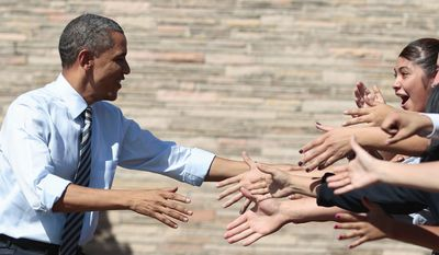 """President Obama shakes hands at Abraham Lincoln High School in Denver on Tuesday. """"He's a good president, but there's no jobs,"""" a student said. (Associated Press)"""