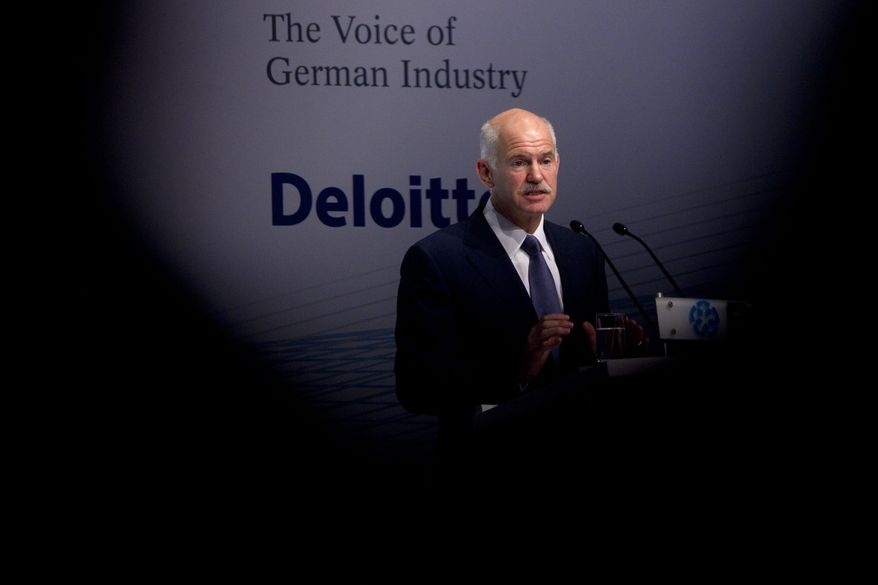 Greek Prime Minister George Papandreou speaks at the annual conference of the Federation of German Industry (BDI) in Berlin on Tuesday, Sept. 27, 2011. (AP Photo/Markus Schreiber)
