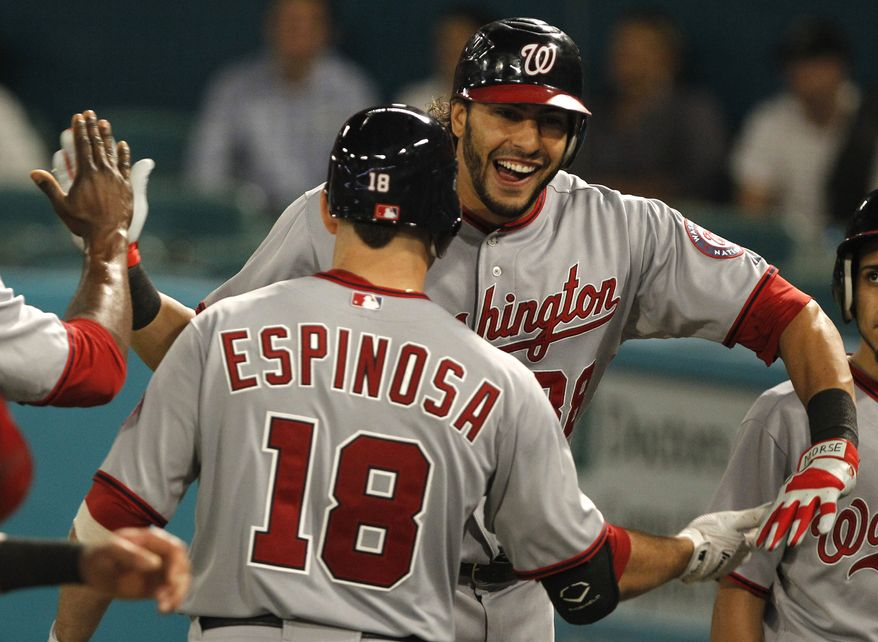 Washington Nationals' Michael Morse celebrates after launching a three-run, game-winning home run against the Florida Marlins in Miami on Monday, Sept. 26, 2011. The Nats won 6-4. (AP Photo/Lynne Sladky)