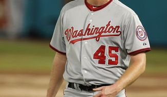 Washington Nationals relief pitcher Doug Slaten watches after Florida Marlins' Bryan Petersen hit a walk-off home run in the ninth inning to defeat the Nationals 3-2 during a baseball game in Miami, Tuesday, Sept. 27, 2011. (AP Photo/Lynne Sladky)