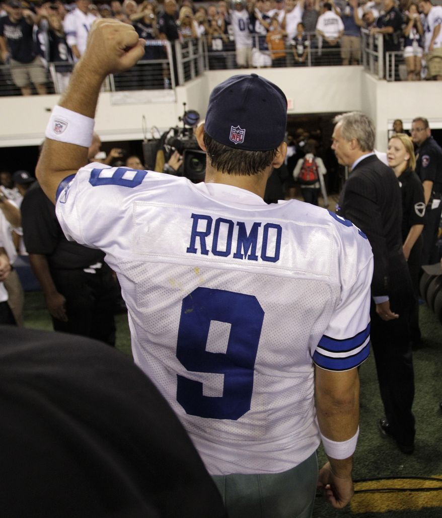 **FILE** Dallas Cowboys quarterback Tony Romo acknowledges cheers from fans as he walks off the field following their 18-16 win over the Washington Redskins on Sept. 26, 2011, in Arlington, Texas. (Associated Press)