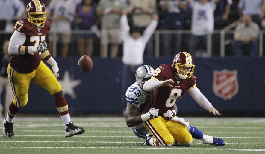 Dallas Cowboys outside linebacker Anthony Spencer causes Washington Redskins quarterback Rex Grossman to fumble near the end of the fourth quarter in Dallas' 18-16 win. (AP Photo/Tony Gutierrez)