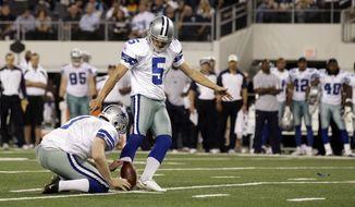 Dallas Cowboys kicker Dan Bailey kicks the game-winning field goal against the Washington Redskins on Monday, Sept. 26, 2011, in Arlington, Texas. The Cowboys won 18-16. (AP Photo/Tony Gutierrez)