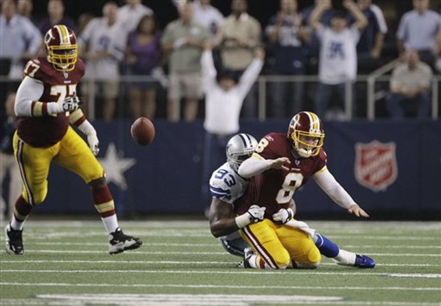 Dallas Cowboys outside linebacker Anthony Spencer tackles Washington Redskins quarterback Rex Grossman for the final play of the Cowboys 18-16 victory during an NFL football game Monday, Sept. 26, 2011, in Arlington, Texas. Washington Redskins' Jammal Brown follows at rear. (AP Photo/Tony Gutierrez)