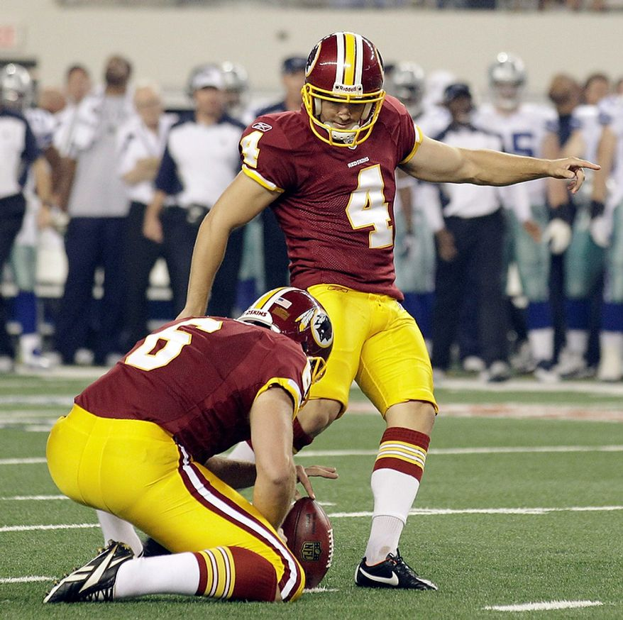 Washington Redskins punter Sav Rocca holds as Graham Gano kicks a field goal against the Dallas Cowboys during the first half of an NFL football game Monday, Sept. 26, 2011, in Arlington, Texas (AP Photo/Tony Gutierrez)