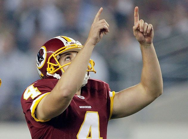 Washington Redskins' Graham Gano gestures after kicking a field goal against the Dallas Cowboys during the first half of an NFL football game Monday, Sept. 26, 2011, in Arlington, Texas. (AP Photo/Tony Gutierrez)