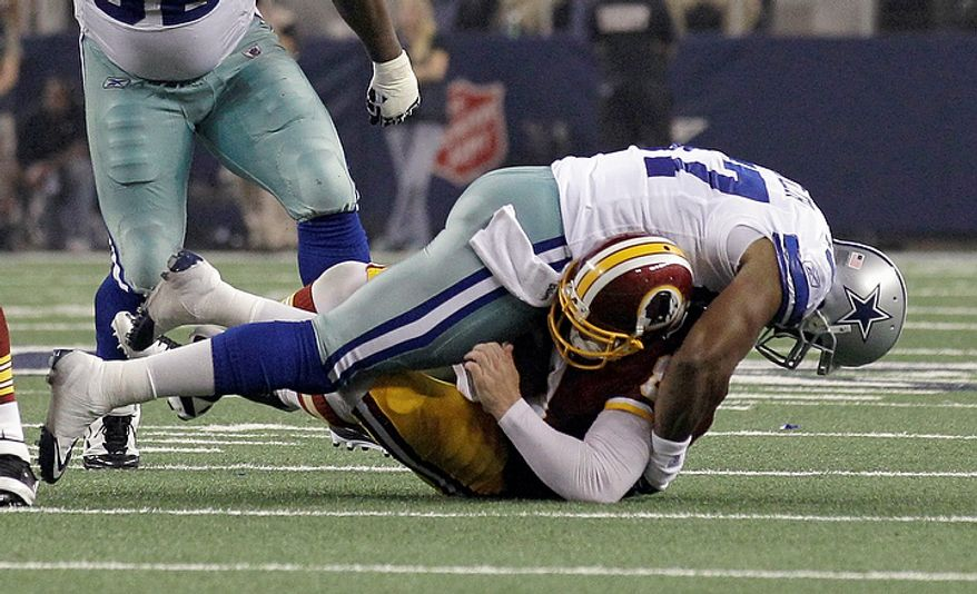 Dallas Cowboys' Victor Butler sacks Washington Redskins quarterback Rex Grossman during the first half of an NFL football game Monday, Sept. 26, 2011, in Arlington, Texas. (AP Photo/Tony Gutierrez)