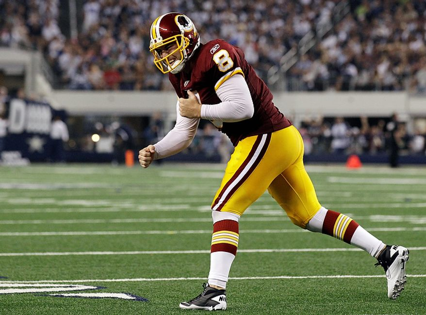 Washington Redskins quarterback Rex Grossman celebrates a second-half touchdown pass to Tim Hightower against the Dallas Cowboys in an NFL football game Monday, Sept. 26, 2011, in Arlington, Texas. (AP Photo/Tony Gutierrez)