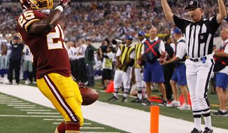 Washington Redskins running back Tim Hightower celebrates after scoring a touchdown against the Dallas Cowboys during the second half of an NFL football game Monday, Sept. 26, 2011, in Arlington, Texas. (AP Photo/LM Otero)