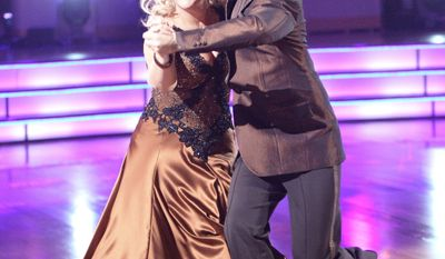 "Nancy Grace and Tristan MacManus perform Monday on ""Dancing With the Stars."" Ms. Grace's costume slipped to bare a breast after the final move of their quickstep routine,. The camera quickly turned toward the audience, and the couple tied for fourth. (ABC via Associated Press)"