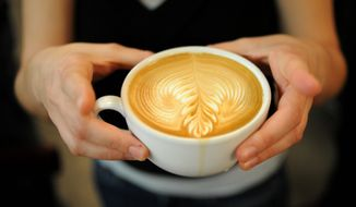 ** FILE ** A latte crafted at Peregrine Espresso in D.C. (The Washington Times)