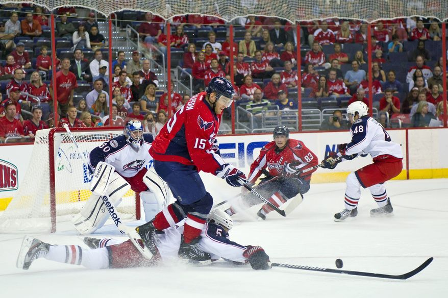 Washington's Jeff Halpern (15) and Jay Beagle (83), shown against Columbus on Tuesday, will be counted on to pressure goalies as well as provide energy from the fourth line. (Andrew Harnik/The Washington Times)