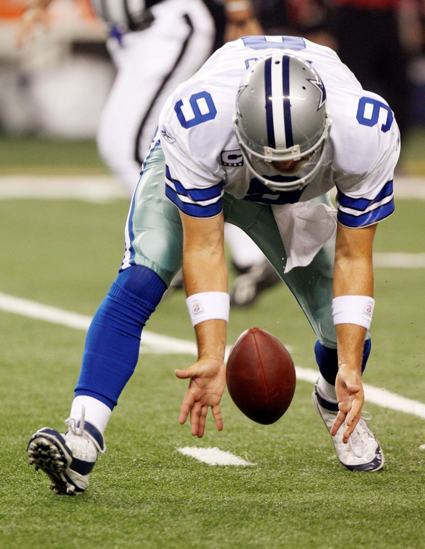 Cowboys quarterback Tony Romo scooping up a fumble was a common sight in Monday night's win over Washington. (Associated Press)