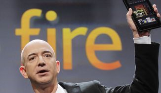 Jeff Bezos, chairman and CEO of Amazon.com, introduces the Kindle Fire at a news conference, Wednesday, Sept. 28, 2011, in New York. The e-reader and tablet has a 7-inch (17.78 cm) multicolor touchscreen. (AP Photo/Mark Lennihan)