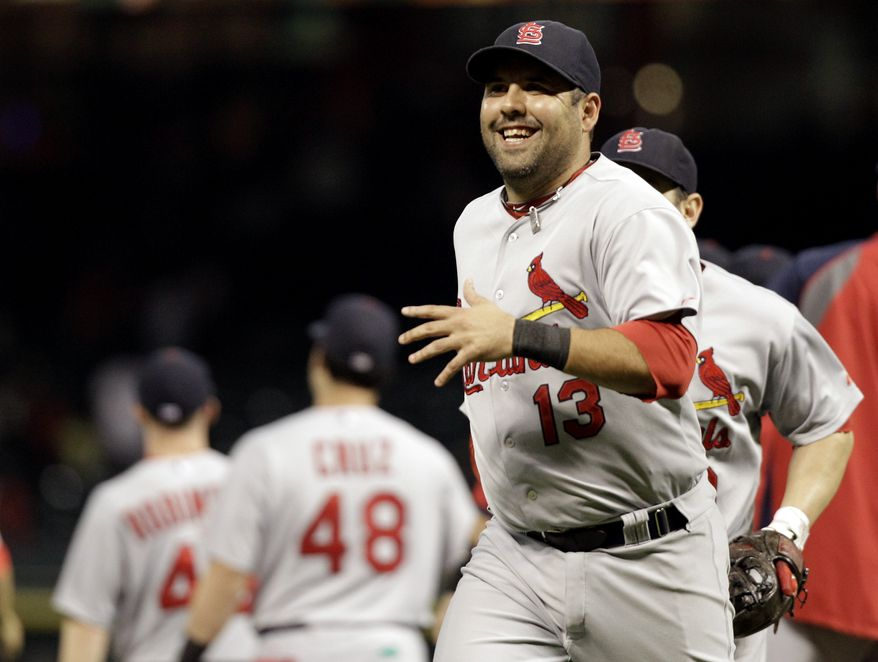 St. Louis Cardinals' Gerald Laird (13) grins as he runs to the dugout after the Cardinals' 8-0 win over the Houston Astros in a baseball game Wednesday, Sept. 28, 2011, in Houston. (AP Photo/David J. Phillip)