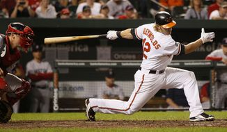 Baltimore Orioles third baseman Mark Reynolds strikes out swinging in the eighth inning of a baseball game against the Boston Red Sox on Tuesday, Sept. 27, 2011, in Baltimore. Reynolds was 0 for 3. Boston won 8-7. (AP Photo/Patrick Semansky)