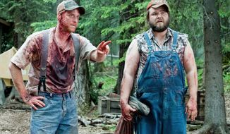 "Alan Tudyk (left) and Tyler Labine star in ""Tucker & Dale vs. Evil."" It's part grisly, low-budget horror spoof, part loopy, role-reversing comedy. (Dan Powers)"