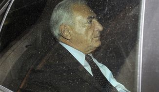 Dominique Strauss-Kahn, former head of the International Monetary Fund, leaves his home in Paris on Thursday, Sept. 29, 2011, on his way to a police station to confront a writer who has accused him of attempted rape. (AP Photo/Yoan Valat)
