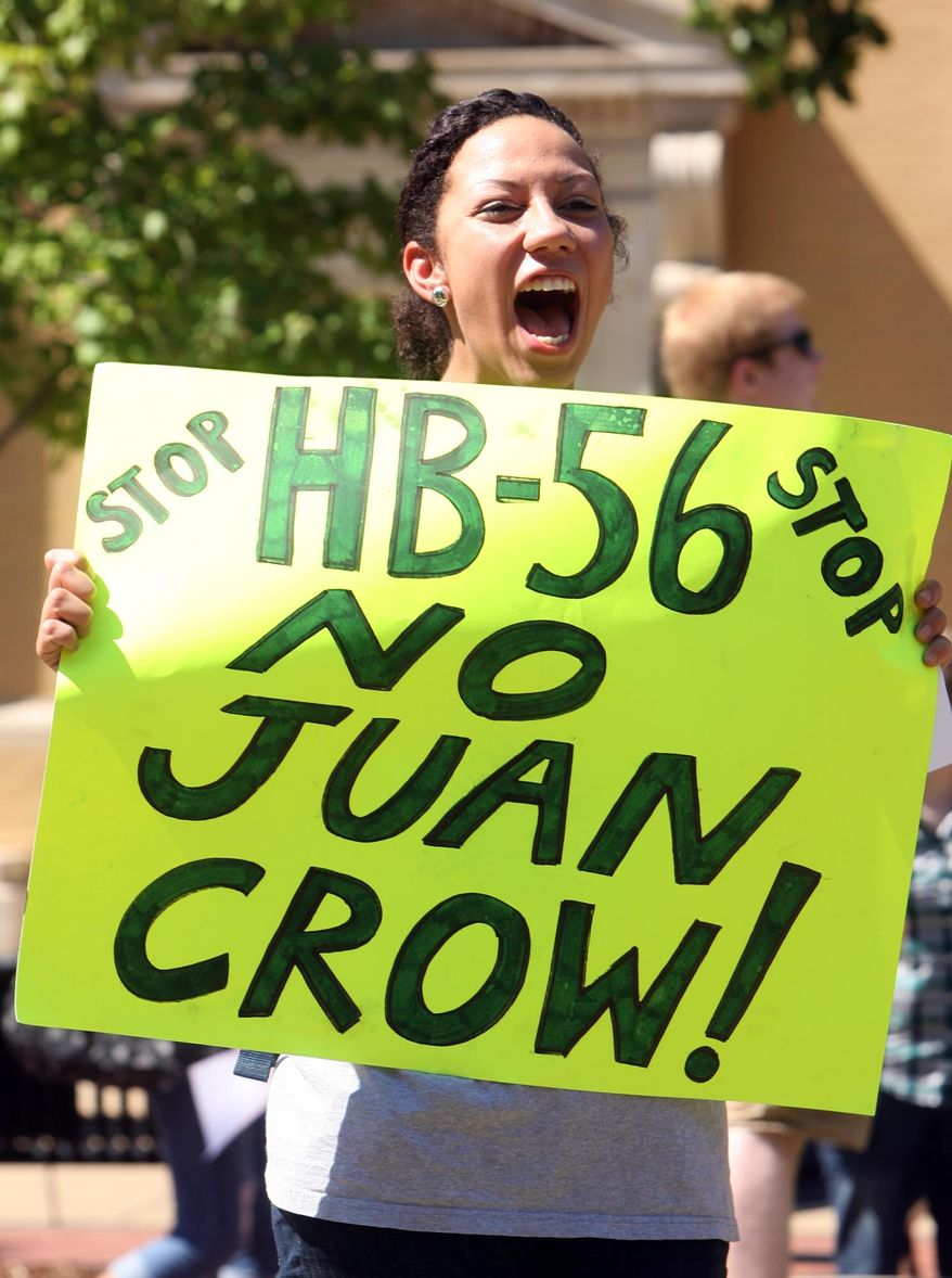 Ashley Hendricks, a University of Alabama student from Huntsville, Ala., holds a sign and chants while protesting the state's immigration bill on Sept. 28, 2011. Hendricks was among approximately 40 students who gathered for a protest of the immigration bill on the school's campus in Tuscaloosa, Ala. (Associated Press/Tuscaloosa News)