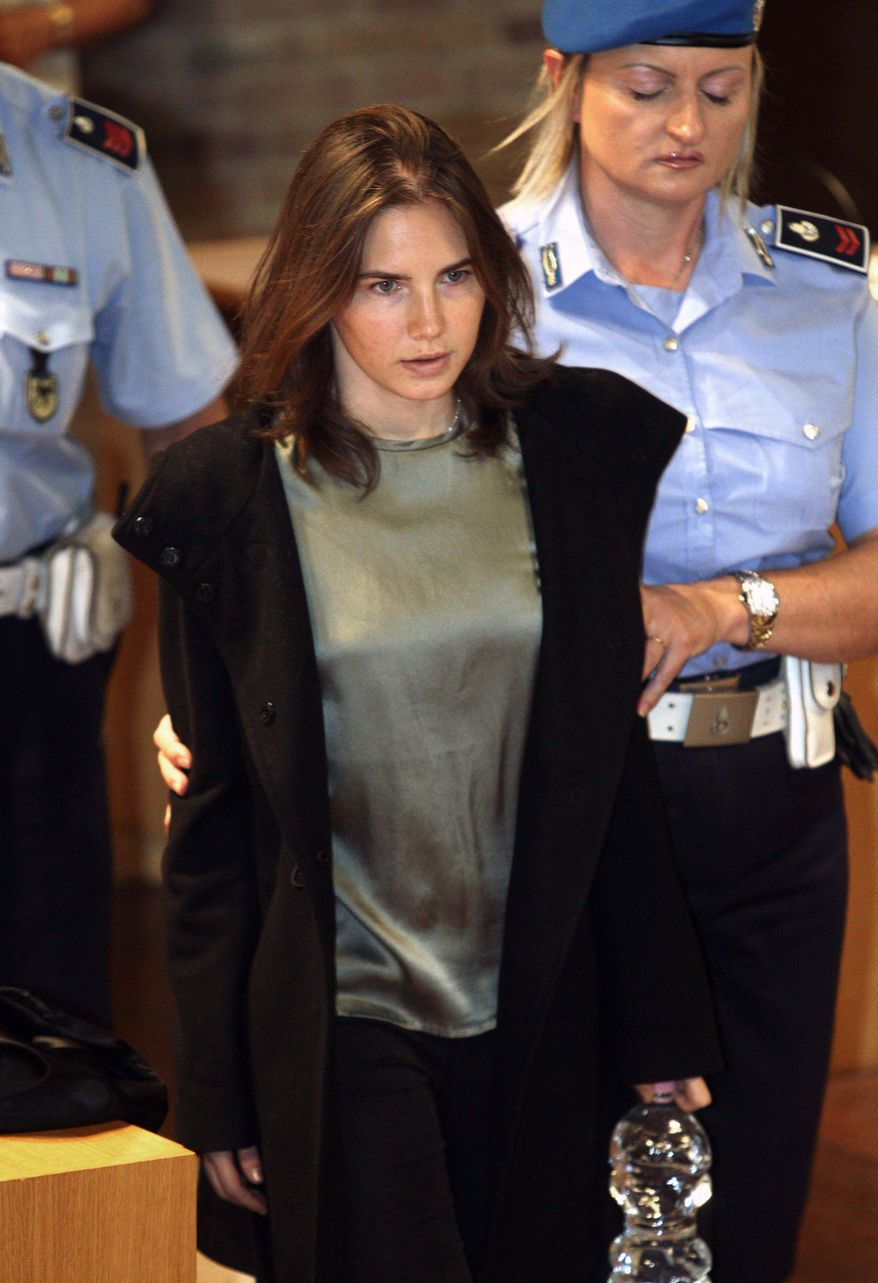 American student Amanda Knox (center) is escorted to court in Perugia, Italy, on Thursday, Sept. 29, 2011. (AP Photo/Pier Paolo Cito)