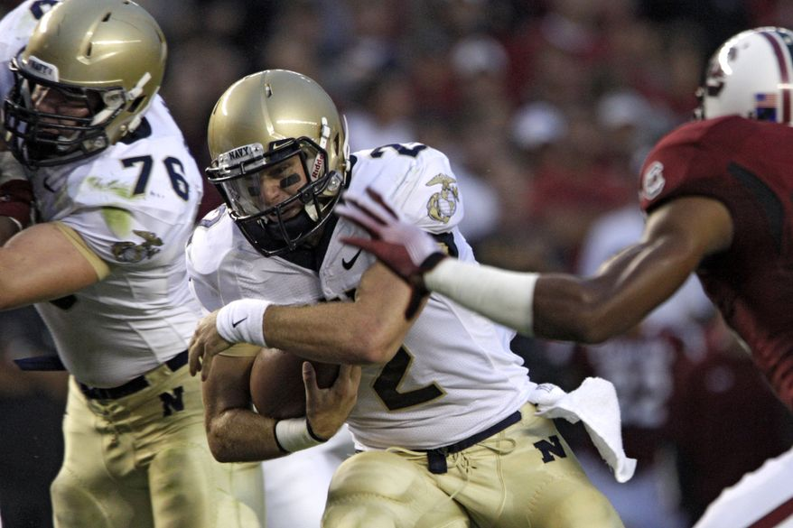 Navy quarterback Kriss Proctor is ready to take back the Commander-In-Chief's Trophy after a seven-year reign as the best service academy. It begins with a reversal of fortunes against Air Force, who beat the Mids 14-6 last season. (AP Photo/Brett Flashnick)