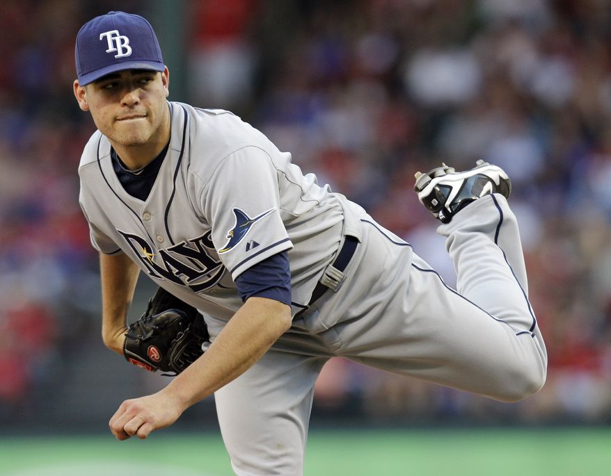 Tampa Bay Rays pitcher Matt Moore delivers to the Texas Rangers during the sixth inning of Game 1 in baseball's American League division series playoffs Friday, Sept. 30, 2011, in Arlington, Texas. (AP Photo/Tony Gutierrez)