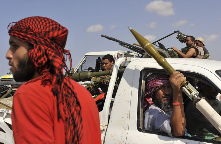 Libyan revolutionary fighters are seen during their attack on the city of Sirte, Libya, on Sept. 30, 2011. (Associated Press)